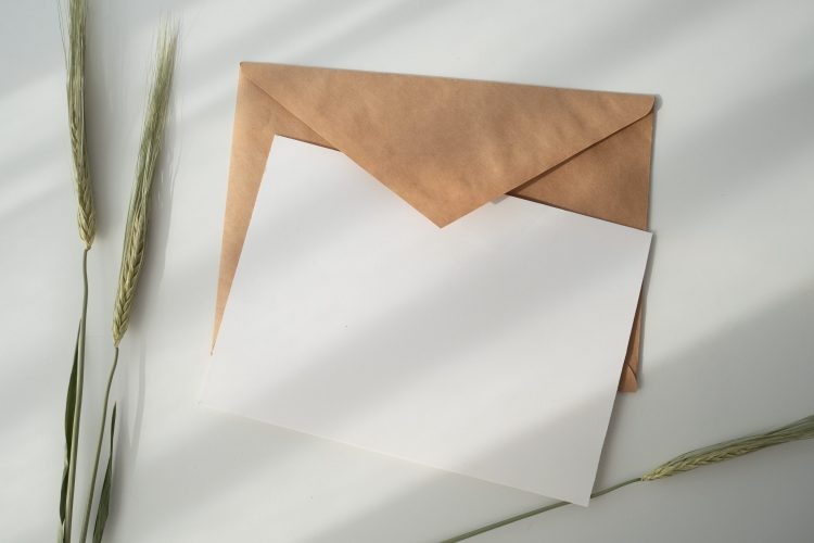 Envelope with paper and pen.